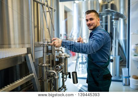 Portrait of brewer working at brewery