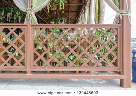 Fence of crossed wooden slats for outdoor cafes