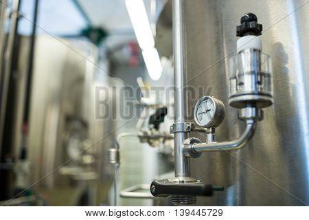 Close-up of barometer at brewery