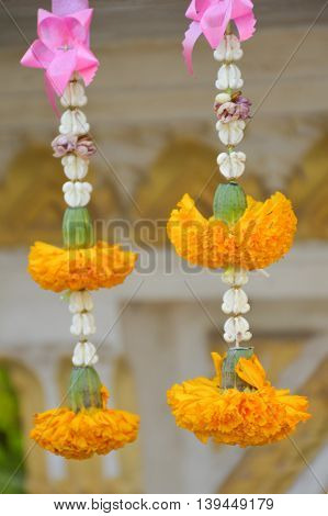 close up beautiful yellow marigold flower garland