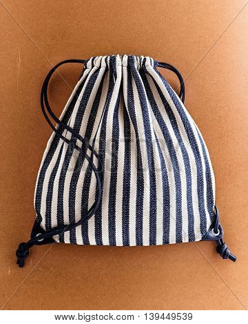 Drawstring cloth backpack on brown eco background
