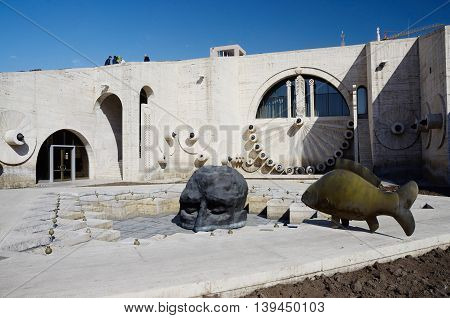 YEREVAN ARMENIA - March 8 2015: Modern art statues human face and fish near Yerevan Cascade giant stairway in Yerevan, Armenia. It's important city landmark completed in 1980