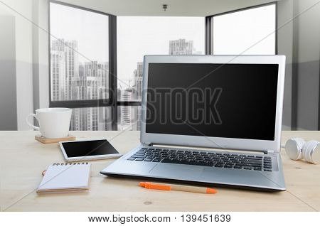 Office table with notepad or tablet computer and equipment office.Tower Building background View from front with notebook space.