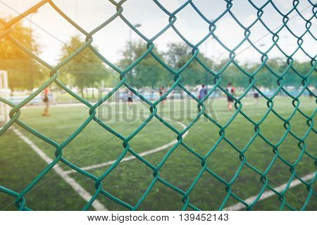 Wire mesh fence from football field with competitive in the public areas in the Thailand country.