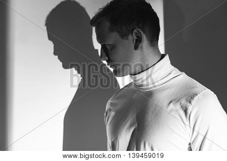 Young Man Afraid Of His Own Shadow