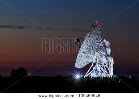 Antenna of radio telescope in astronomical observatory.