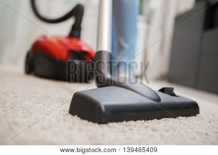 Black vacuum cleaner brush closeup. Carpet cleaning indoor