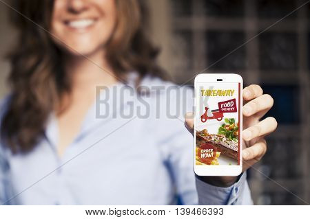 Woman ordering food by internet with a mobile phone.