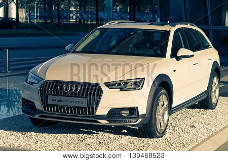 Munich Germany - May 6 2016: A4 allroad quattro new car model of Audi 4WD SUV crossover. Outdoor stock photo with split toning effect was captured in a public place with free access.
