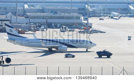 Munich Germany - May 6 2016: Armed police armored vehicle ensures antiterrorism attack defense measures for Israeli El-Al airliner in Munich internetional passenger airport.