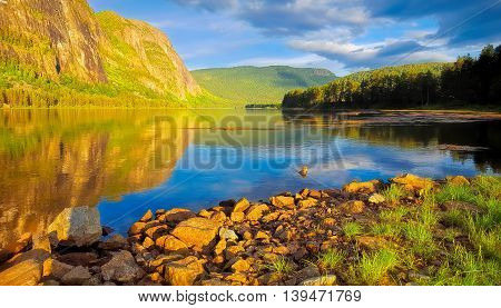 Peaceful lake, trees and sunset at Setesdalen, Norway