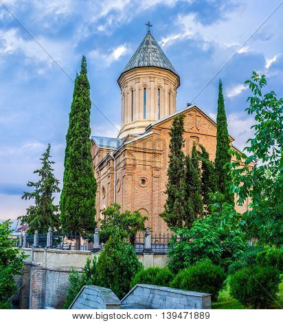 The Ejmiatsin Church of Armenian Apostolic church surrounded by sypresses located in Avlabari District Tbilisi Georgia.