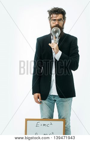 young handsome bearded man scientist or professor in glasses with long beard holding teacher board with einstein formula and newtons law isolated on white background poster