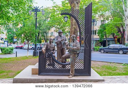 YEREVAN ARMENIA - MAY 29 2016: The monument of three Armenian musicians masters of play on traditional woodwind instruments - dudukes on May 29 in Yerevan.