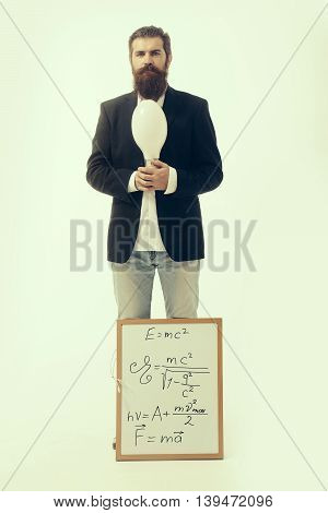 young handsome bearded man scientist or professor with long beard holding teacher board with einstein formula and newtons law isolated on white background poster