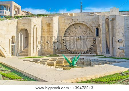 YEREVAN ARMENIA - MAY 29 2016: The fouth level of Cascade with the eafle relief on the wall fountain on May 29 in Yerevan.