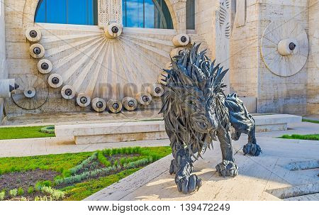 YEREVAN ARMENIA - MAY 29 2016: The black lion made of tires by Ji Yong-Ho decorates the third level of Cascade on May 29 in Yerevan.