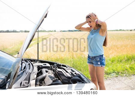Woman with Broken Down Car