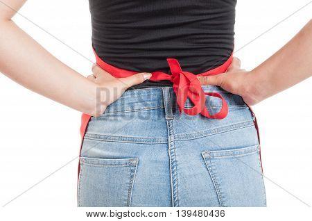 Closeup Back Of Female Employee Wearing Red Apron