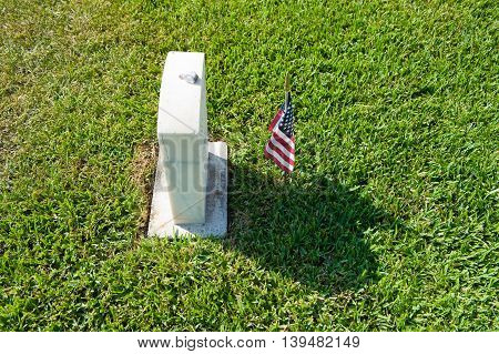 KEY WEST FLORIDA USA - MAY 02 2016: American flag on the grave at the battleship Maine memorial section at Key West cemetery.