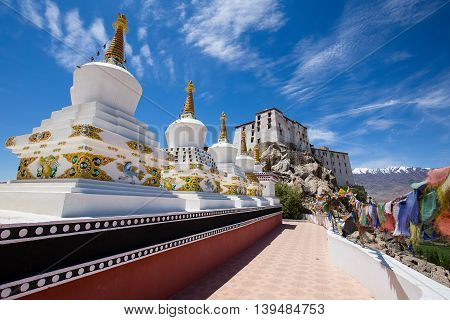 Buddhist white stupa and blue sky in the background in Thiksey Monastery in Leh Ladakh India. Close up
