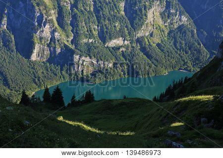 Lake Klontalersee seen from Obere Scheiterboden. Summer scene in the Swiss Alps.
