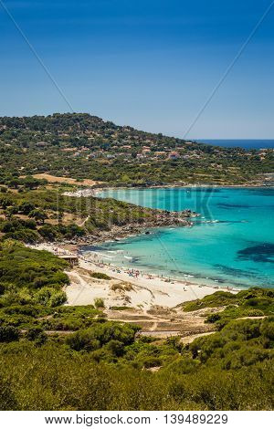 Holidaymakers And Turquoise Water At Bodri Beach In Corsica