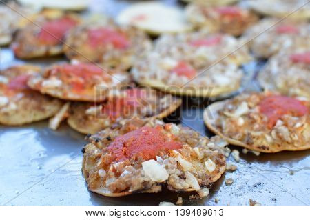 Mini tostadas with toppings of meats and veggies - traditional street food at local markets in Quetzaltenango Guatemala. Shallow depth of field