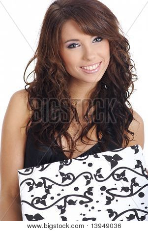 sexy  woman smiles and holding a gift in packing