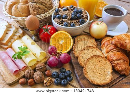 continental breakfast - food on wood background