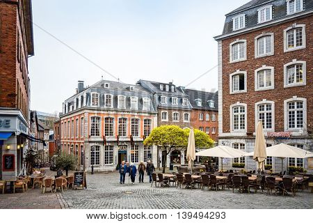 Aachen, Germany - April 13 : Tourists on foot Street in Aachen, Germany. Aachen was a residence of Charlemagne, and later the coronation place for German kings. April 13, 2016 in Aachen, Germany