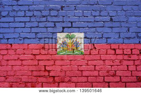 Flag of Haiti painted on brick wall background texture