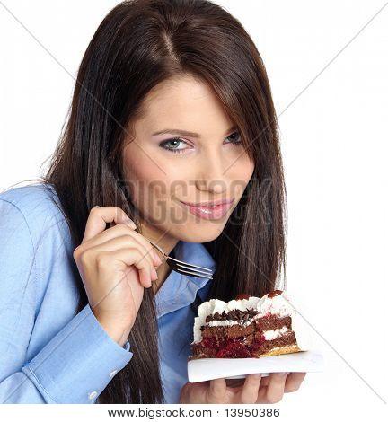 woman wearing blue shirt eating the cake.