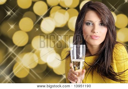Sexy happy woman with champagne over holiday light background