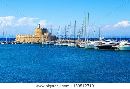 Boats in Mandraki Harbor. Rhodes Town, Rhodes, Greece