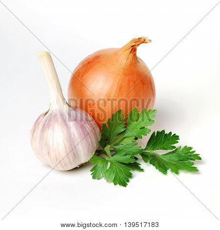 Garlic, parsley and onion isolated on white background