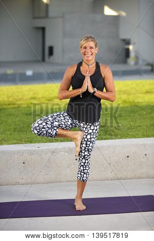 Healthy woman performing yoga in the park