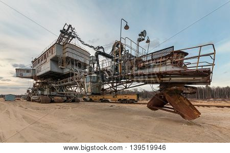 Many buckets of giant quarry excavator Equipment for the extraction of sand from the quarry. Back view