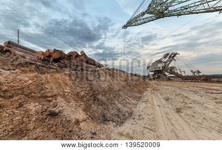 Many buckets of giant quarry excavator Equipment for the extraction of sand from the quarry. View from the semi-abandoned quarry