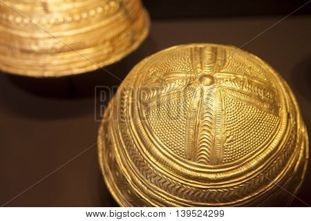 Madrid, Spain - July 11, 2016: Two tartessian golden helments. Closeup at National Archeological  Museum of Madrid