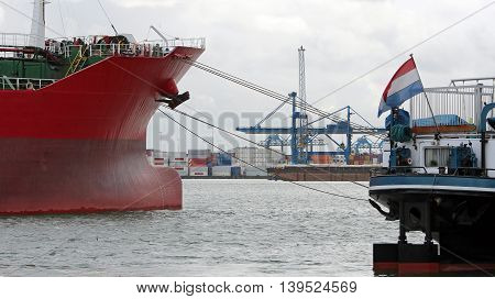 Large Container Ship Moored in a Harbor. Industrial container freight trade port scene.