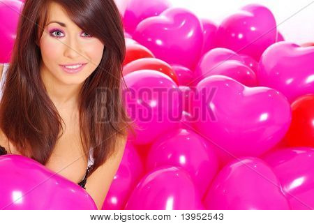 Beautiful girl over pink balloons background