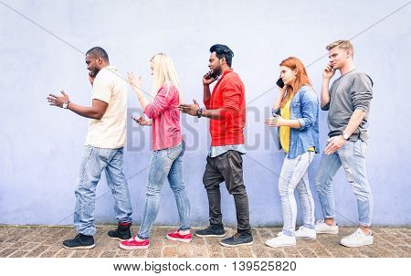 Multiracial row of young people using mobile phone walking on urban street - Teenagers queue talking at cell outdoor on blue background - Concept of addictiont to technology