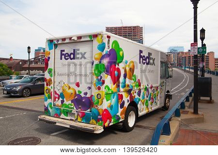 BOSTON,MASSACHUSETTS,USA - JULY 15,2016: FedEx Special Delivery truck on the street in Boston. FedEx is one of the leading package delivery services.