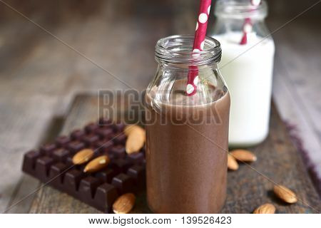 Chocolate And Regular Milk In A Vintage Bottles With Paper Straws.