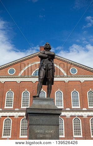 BOSTON, MASSACHUSETTSUSA - JULY 15,2016: Statue of Revolutionary Patriot Samuel Adams 1722-1803 in front of historic Faneuil Hall Boston MA