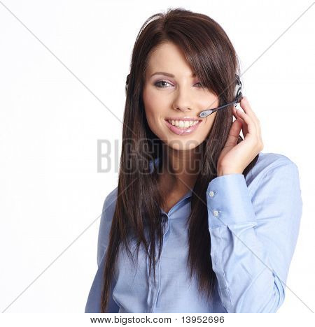 Beautiful Customer Representative with headset smiling during a telephone conversation