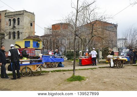 Istanbul Turkey - February 26 2013: Istanbul Golden Horn vendors selling grilled fish in coastal