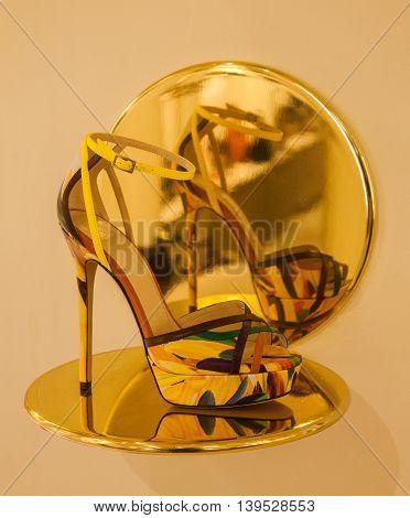 High Heel Shoe Reflected in a Brass Mirror