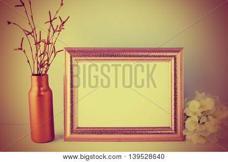 Vintage toned gold frame mockup. Landscape gold frame mockup romantic style. Empty golden frame mockup for design presentation.